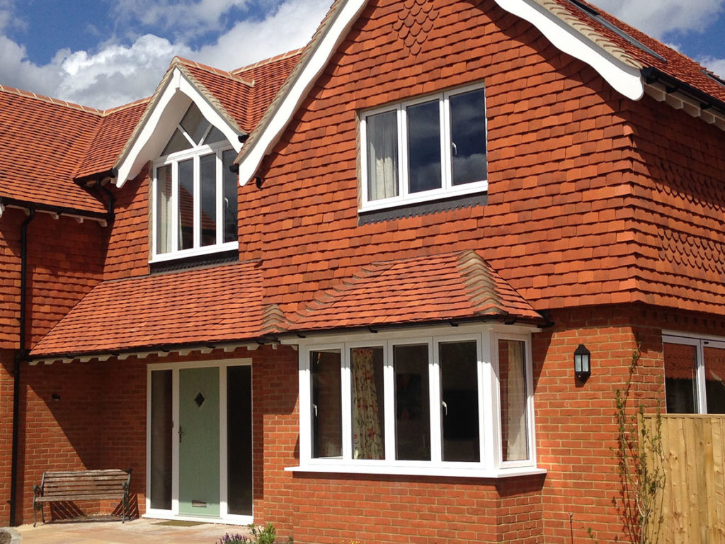 Handmade Orange Verticle Angle Tile fitted by Tilemongers in Hampshire.